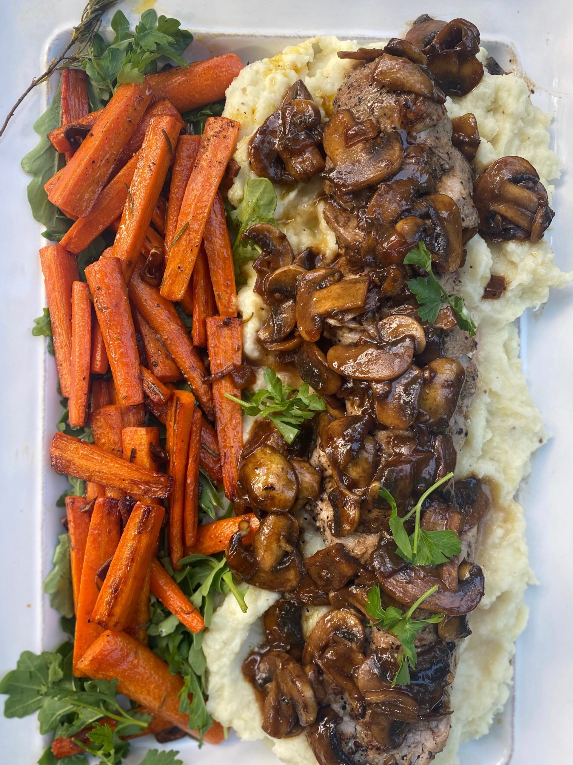 garlic rosemary carrots with pork tenderloin and mashed potatoes