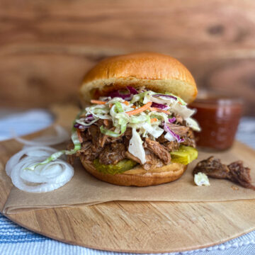 pulled pork sandwiches with homemade BBQ sauce and coleslaw on brioche bun slow cooker