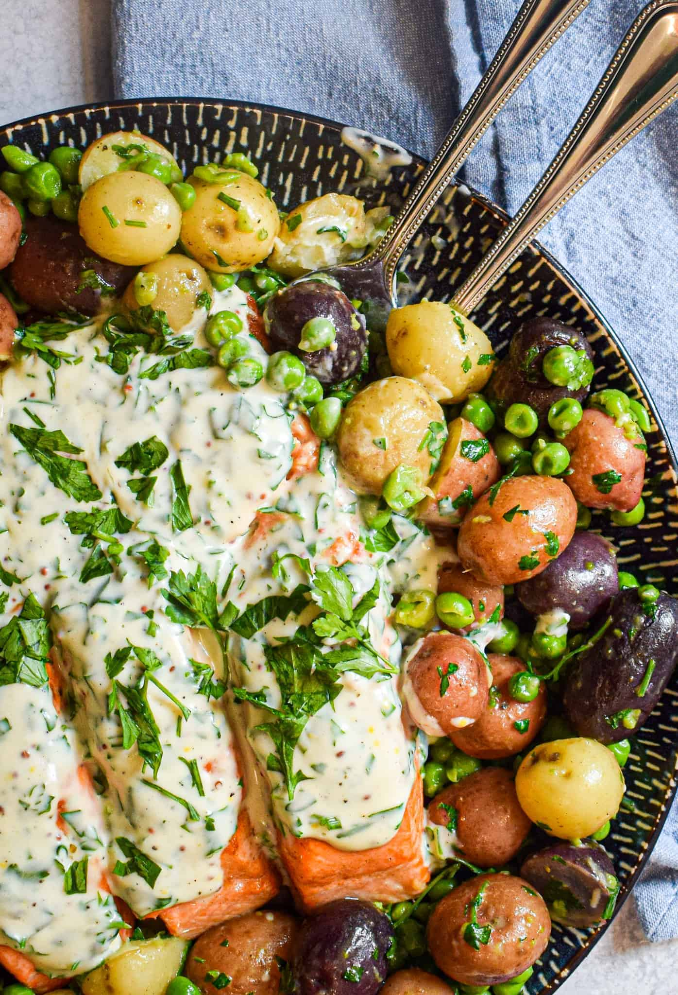 seared salmon with parsley sauce and steamed peas and potatoes