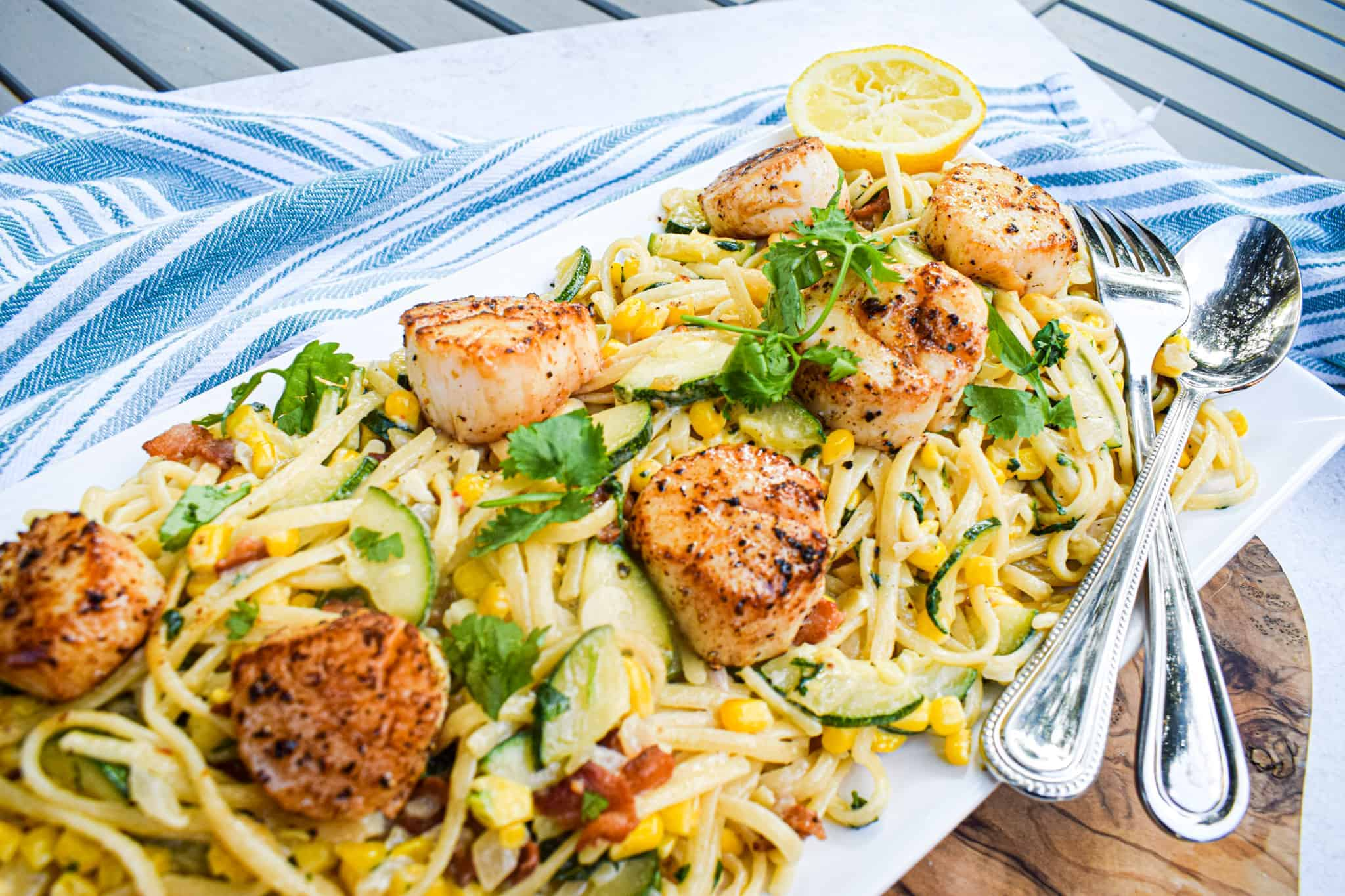 summer pasta recipe with corn zucchini scallops and bacon