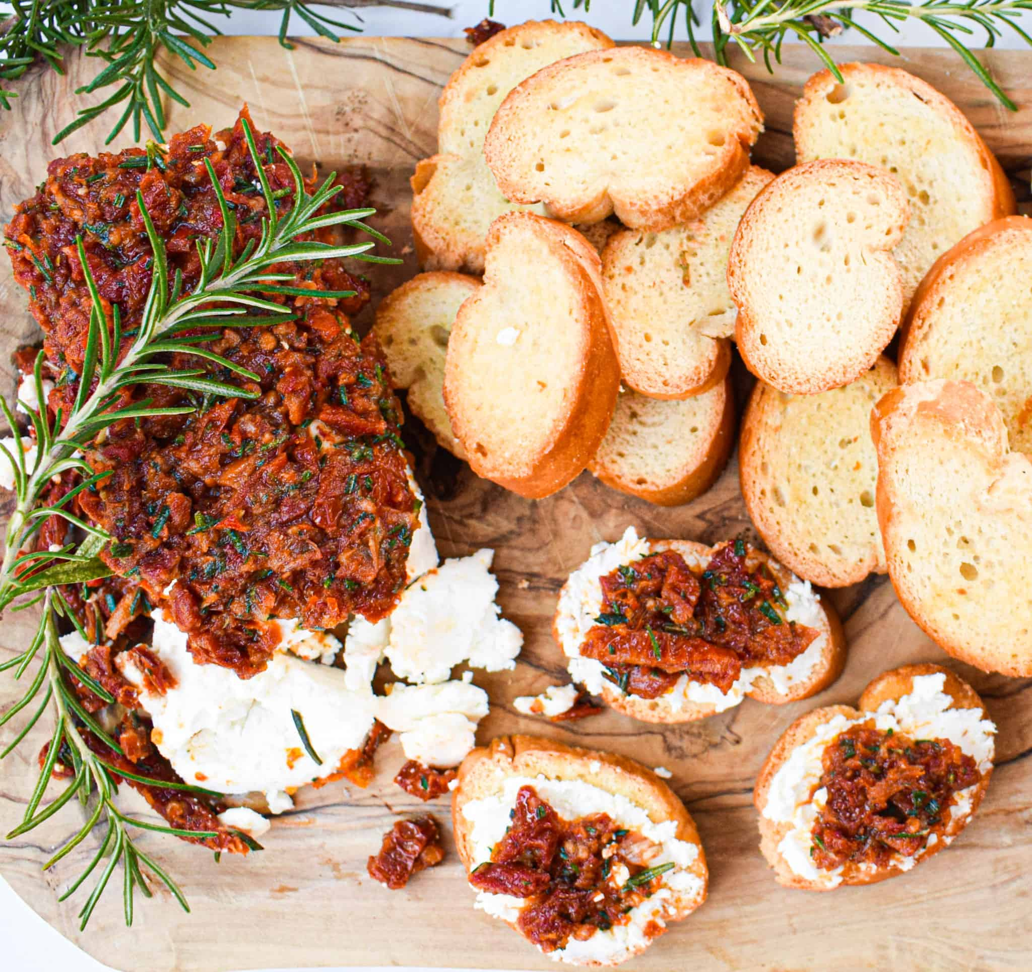 Goat Cheese Crostini with Garlic & Rosemary Sun-dried Tomatoes on toasted baguette perfect holiday appetizer by the jam jar kitchen