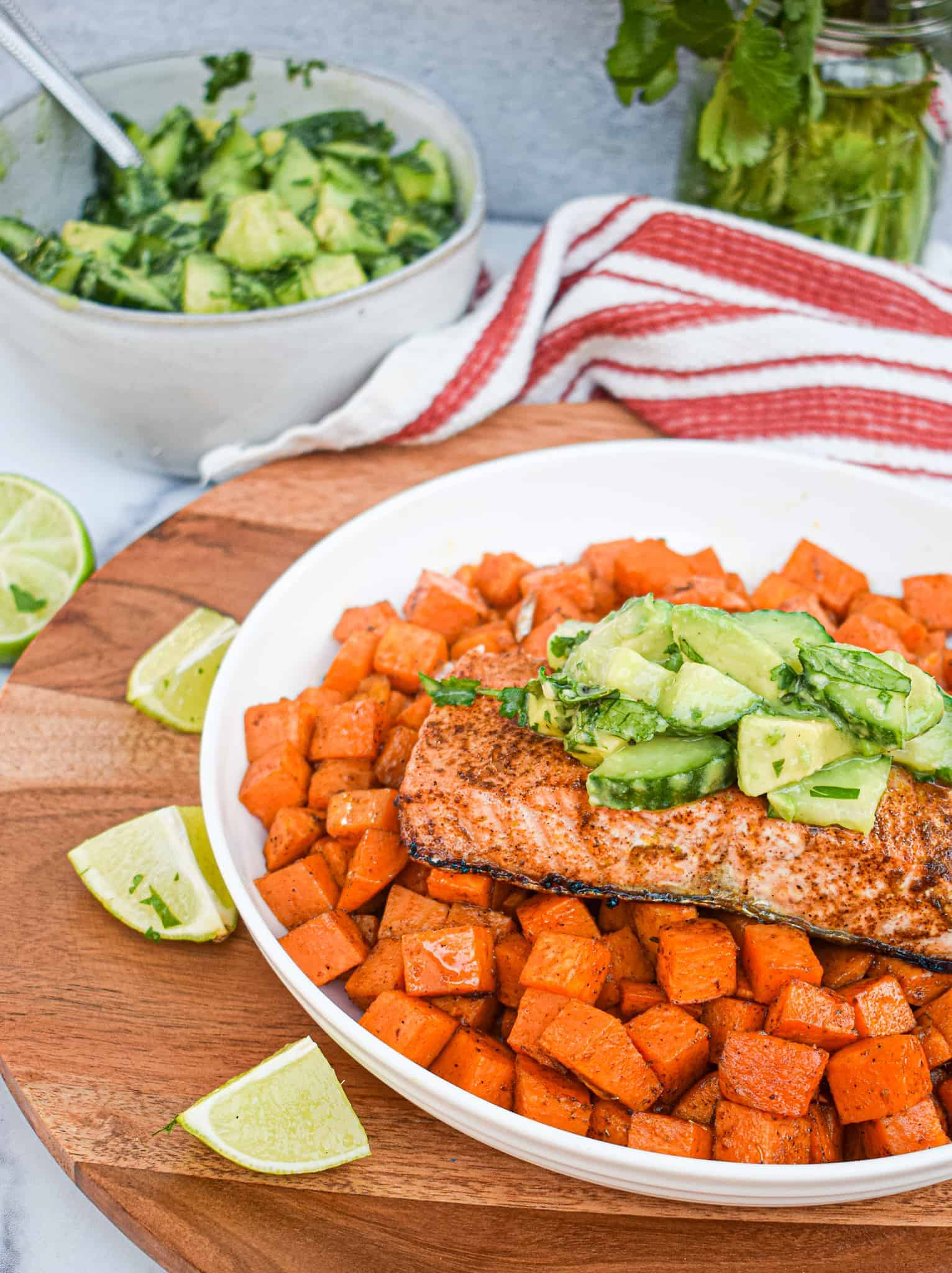 whole30 chili lime salmon with mexican spiced sweet potatoes and a cucumber avocado and lime salad