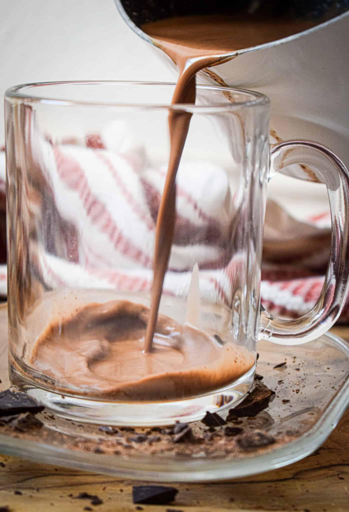 Paleo hot chocolate poured into a glass mug by the jam jar kitchen
