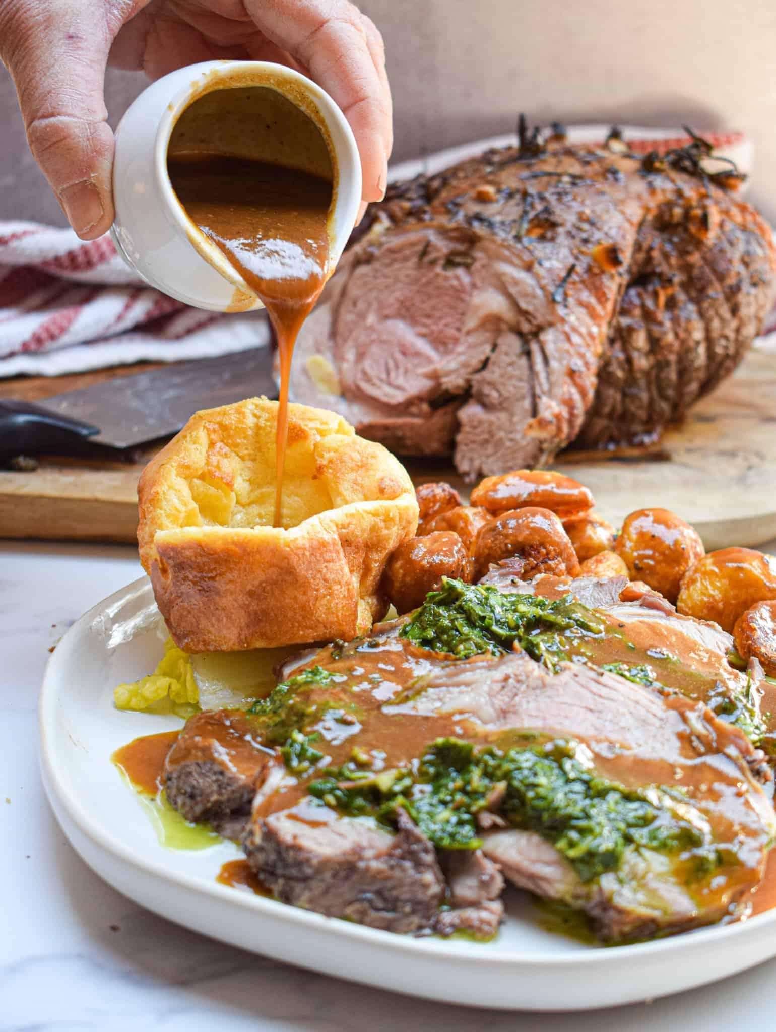 roast leg of lamb with british roasties roast potatoes and yorkshire pudding