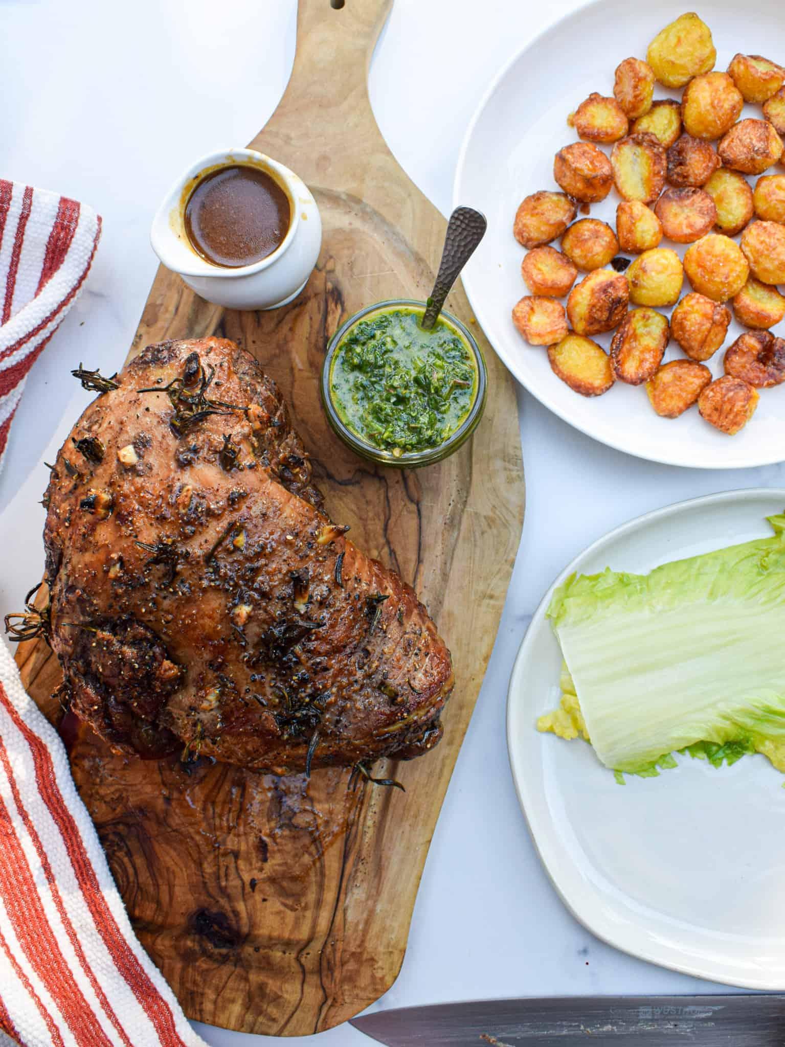 roast lamb with roasties roast potatoes and mint chimichurri