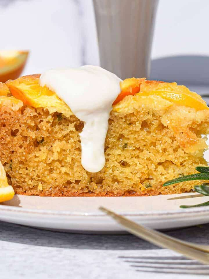 Meyer Lemon Orange Rosemary Olive Oil Cake topped with honey greek yogurt