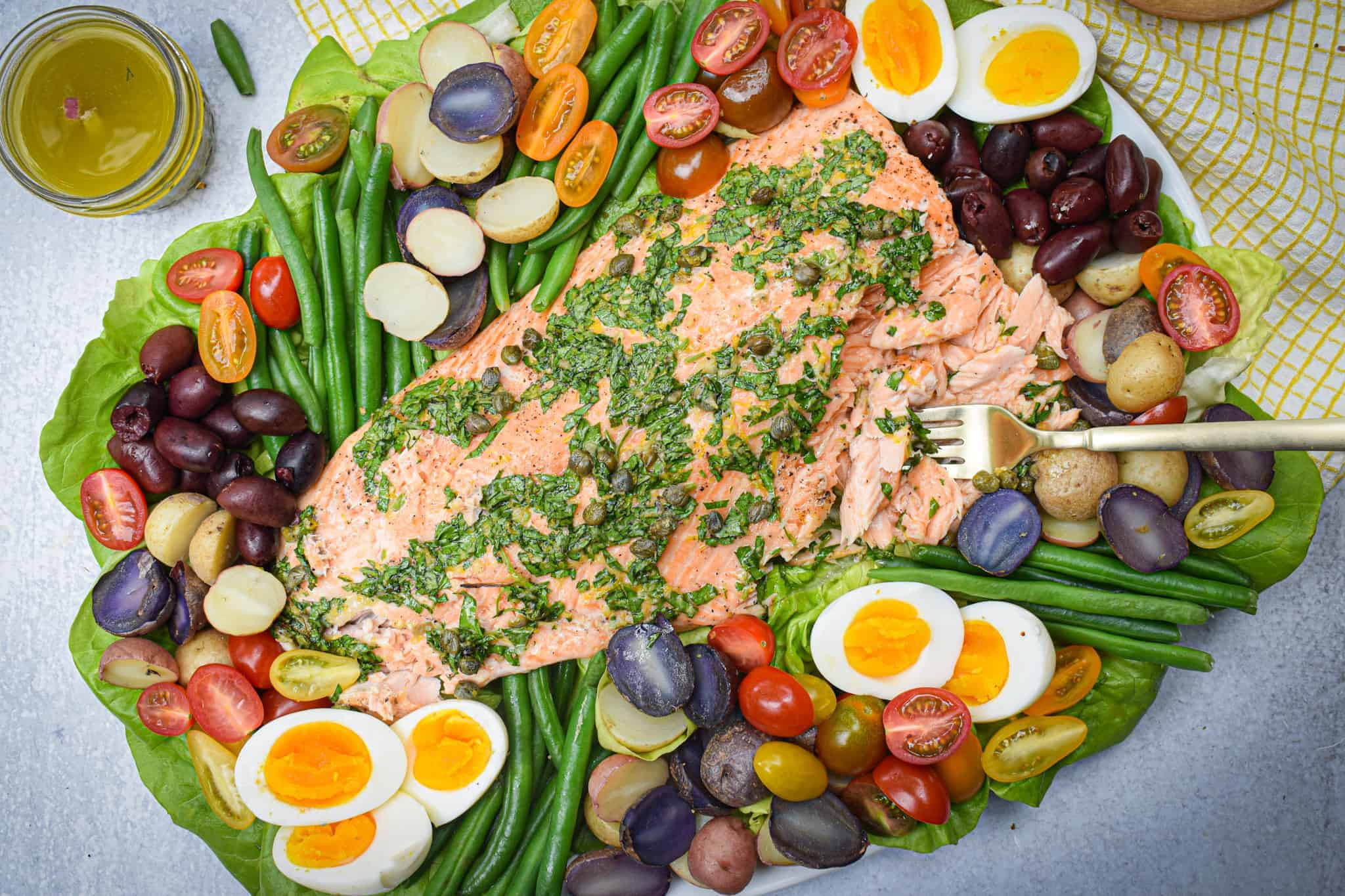 Whole30 Salmon Nicoise Salad on a large platter with Bluehouse Salmon