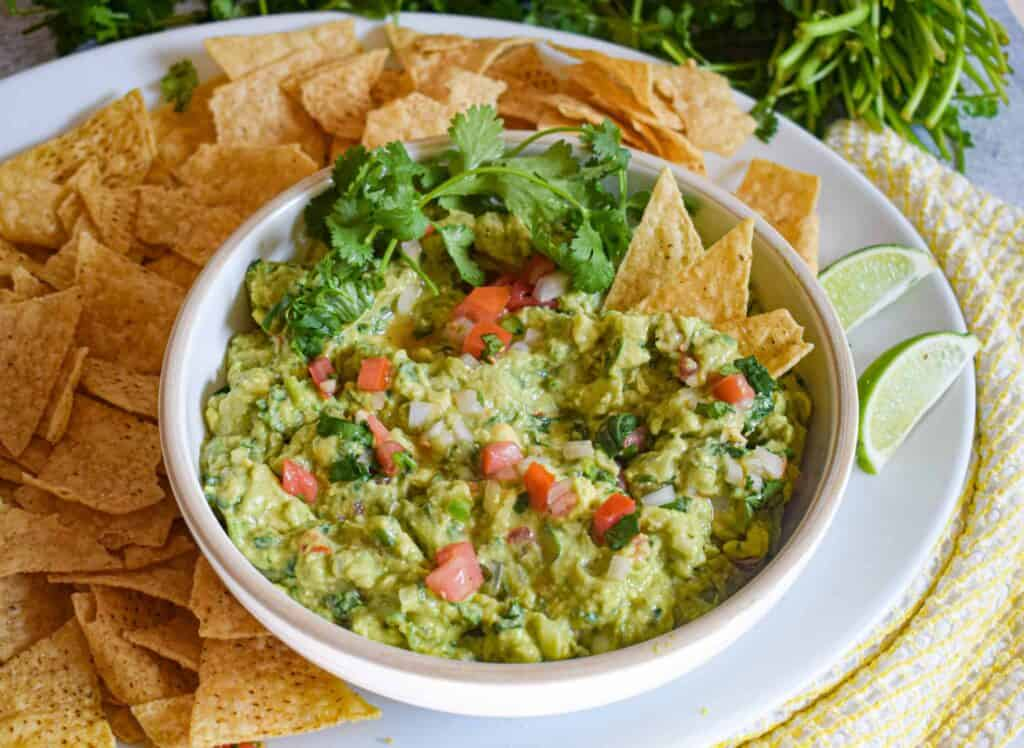 my favorite easy and delicious guacamole with tortilla chips by the jam jar kitchen