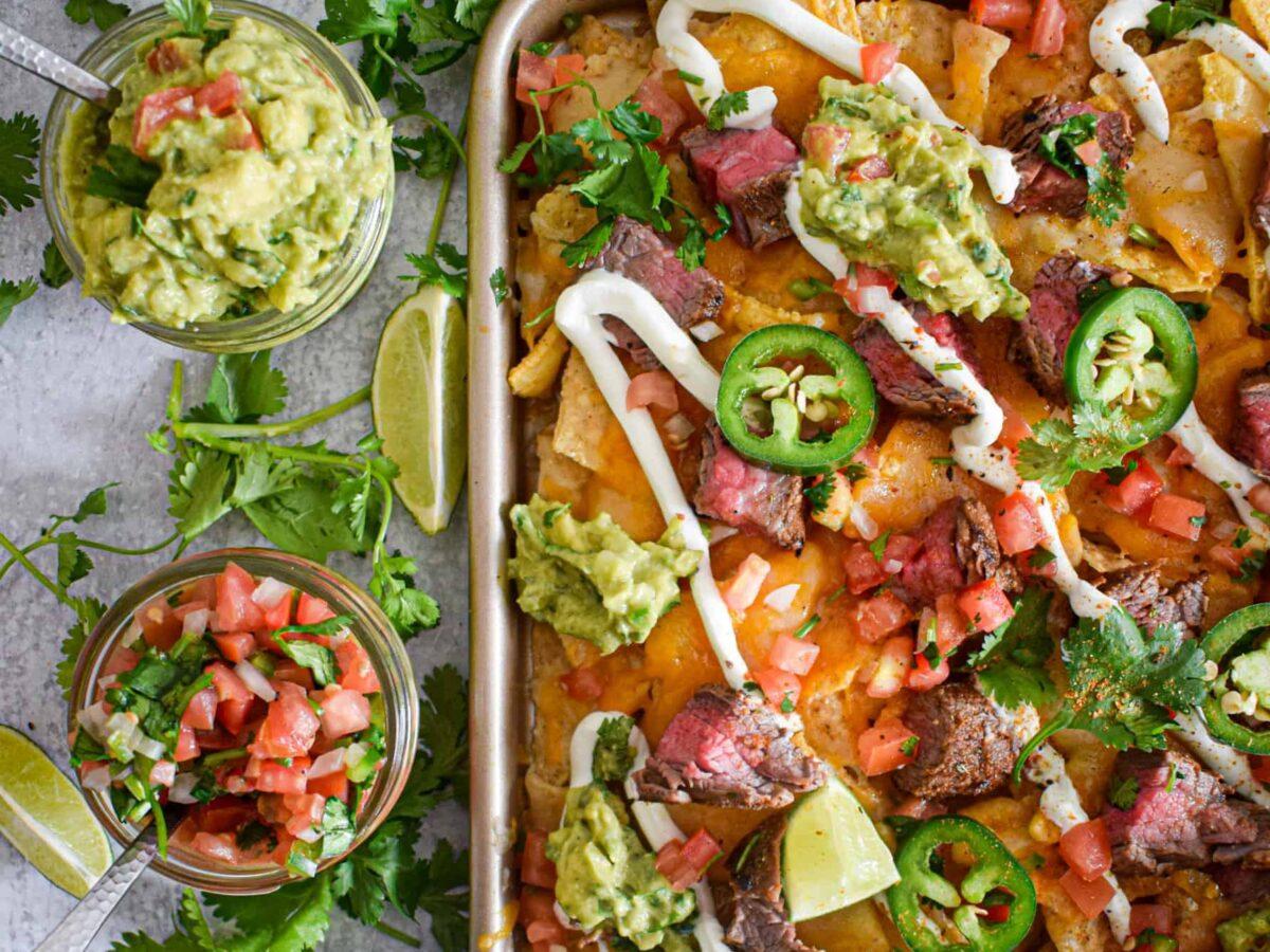 flank steak nachos with guacamole and pico de gallo