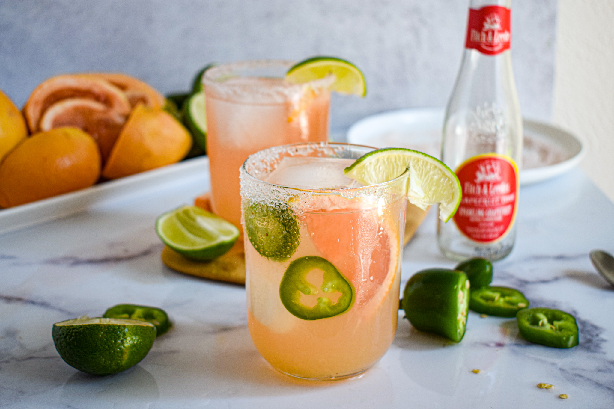 paloma cocktail with jalapeno slices