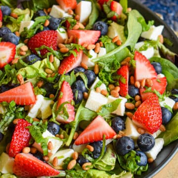 4th of july red white and blue salad with berries mozzarella basil and balsamic