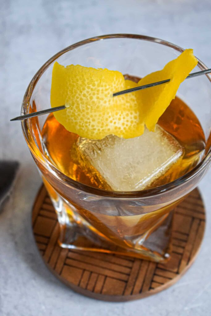 sweet tea old fashioned cocktail with rye whiskey bourbon and tea infused simple syrup