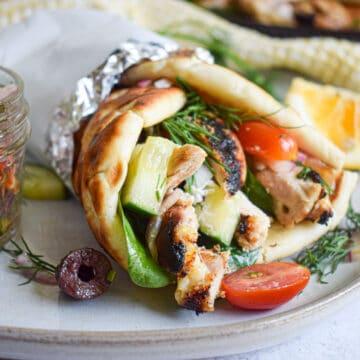 Greek grilled chicken gyro with homemade tzatziki and greek cucumber salad