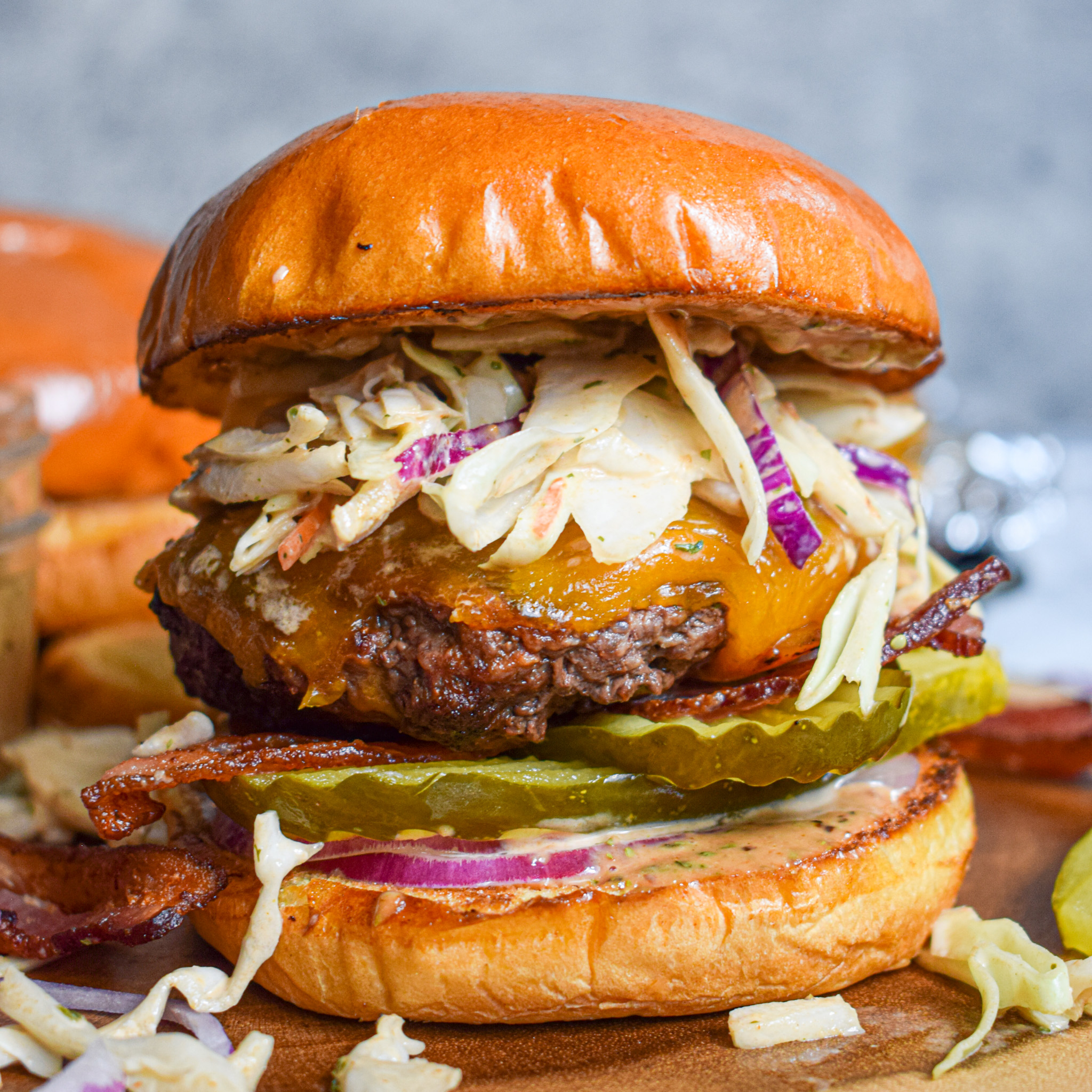 BBQ Ranch burger with bacon and cheddar cheese