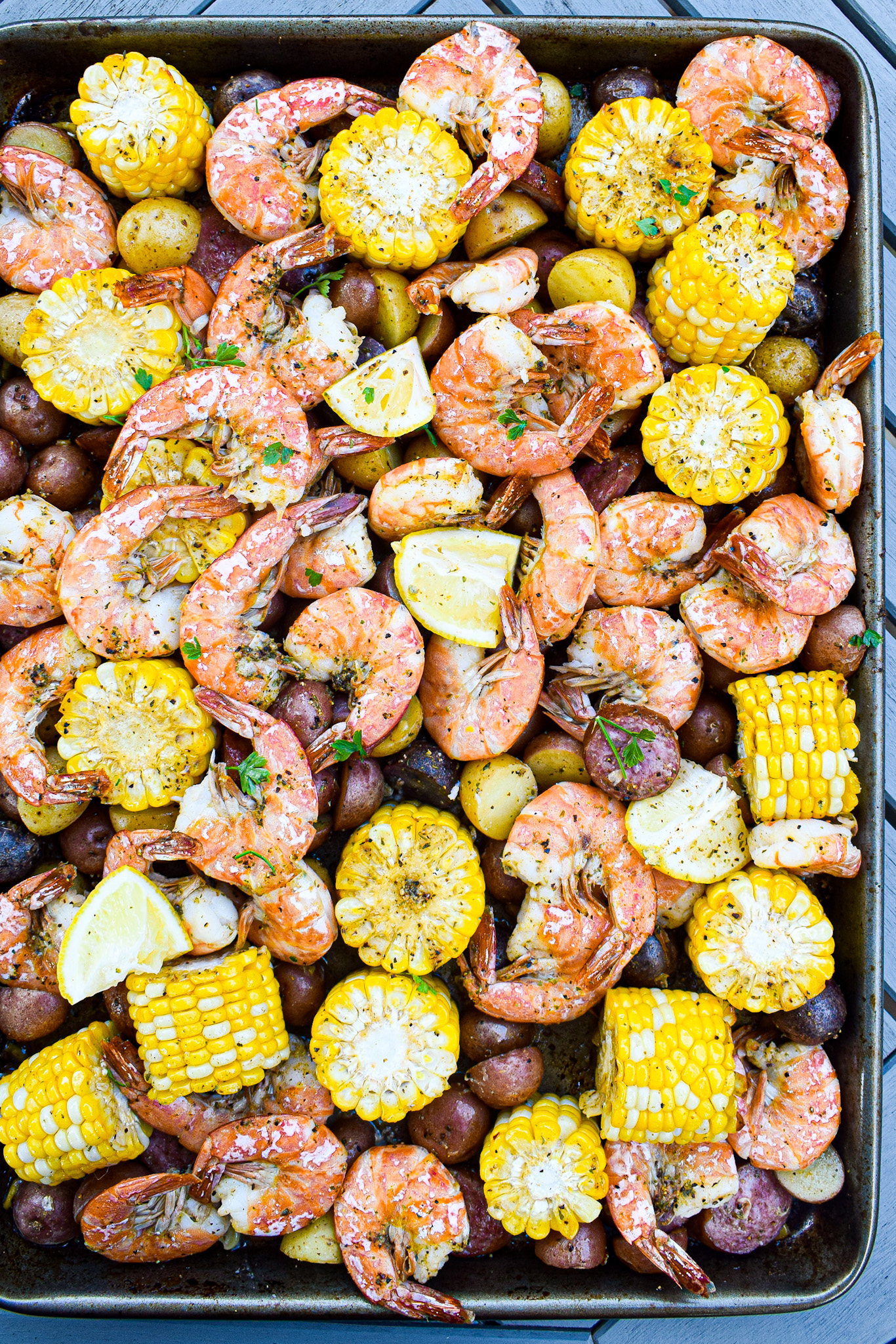 sheet pan shrimp boil with andouille sausage, corn and potatoes