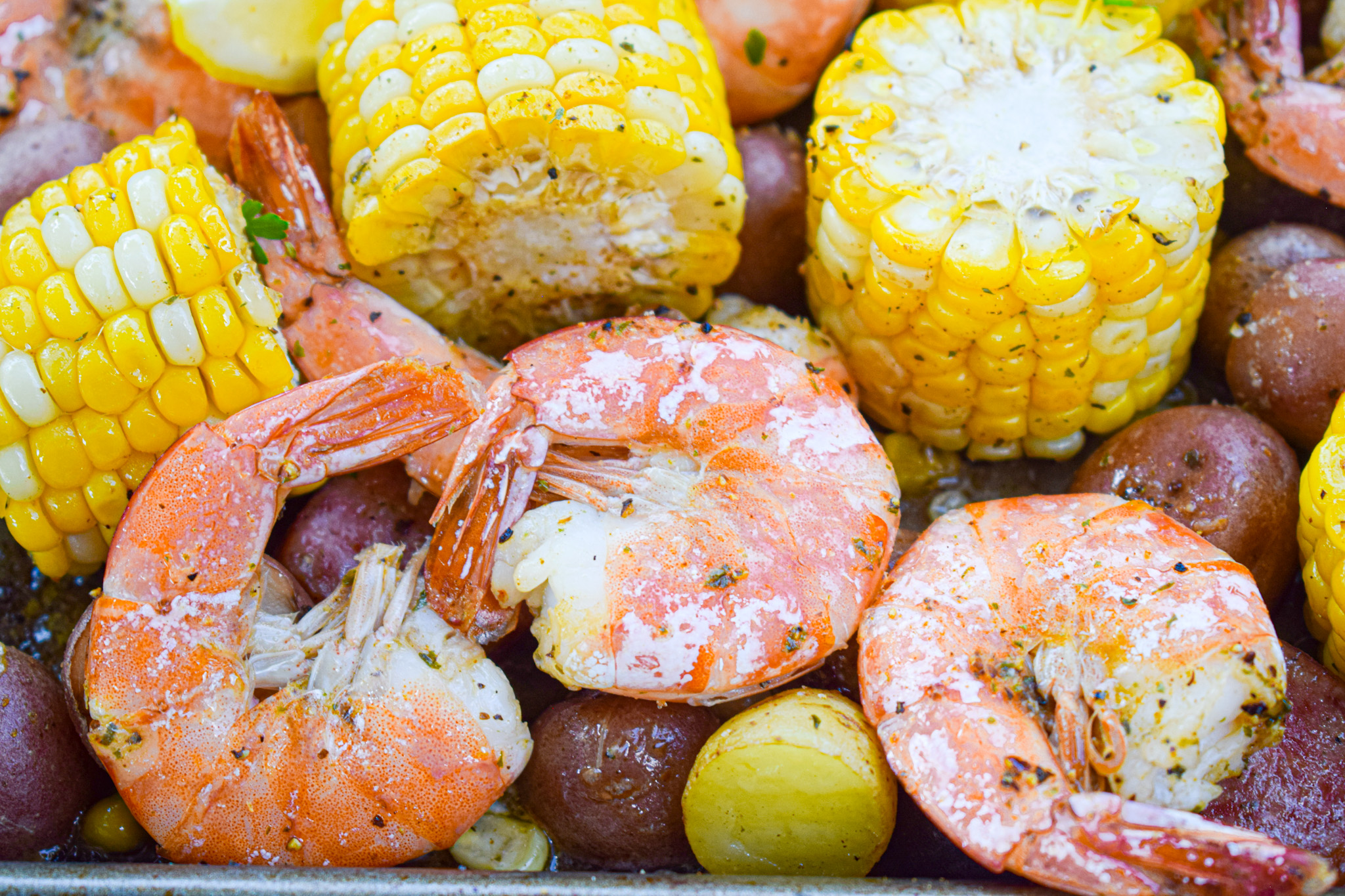 low country sheet pan shrimp boil with corn on the cob and seafood seasoning easy weeknight meal