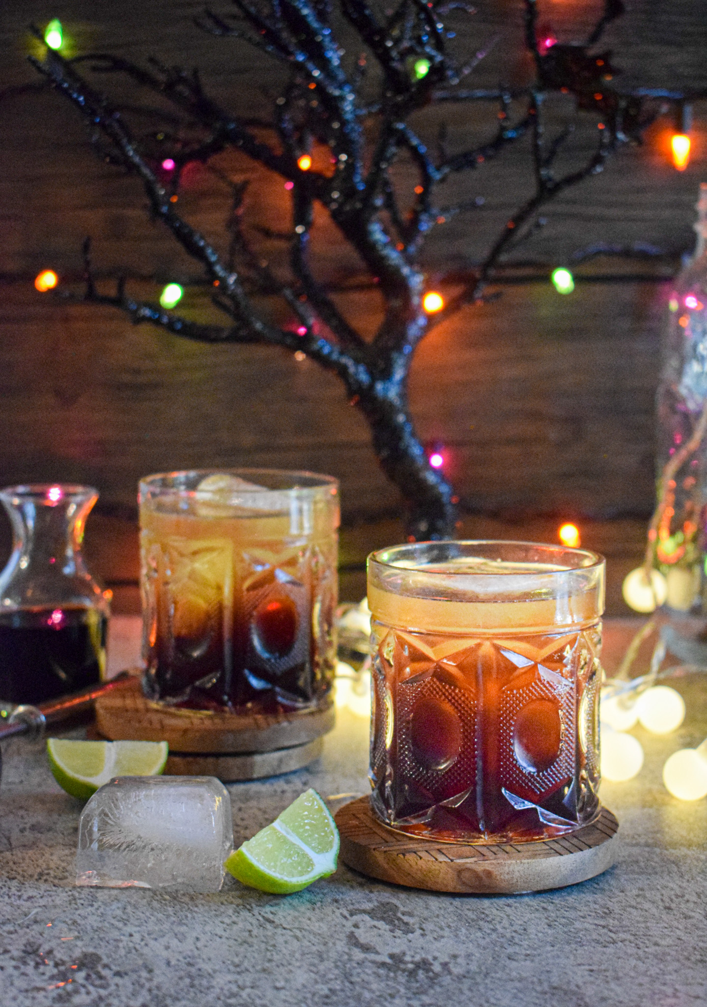spooky halloween gin cocktail recipe with amaretto lime black cherry and tonic